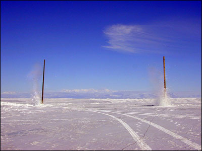 Blasting power poles out of the ice