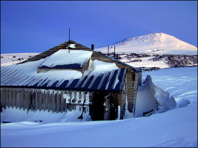 Hut at Cape Evans with Mt. Erebus behind