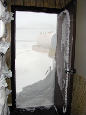 Snow piled up outside the door