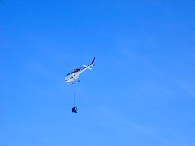 Helicopter with sling load at Marble Point