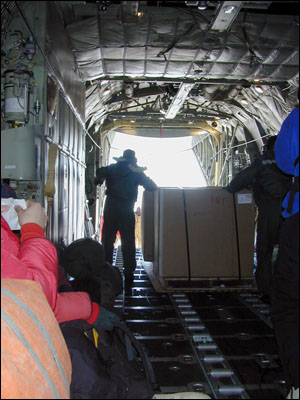 C-130 interior doing a cargo off-load